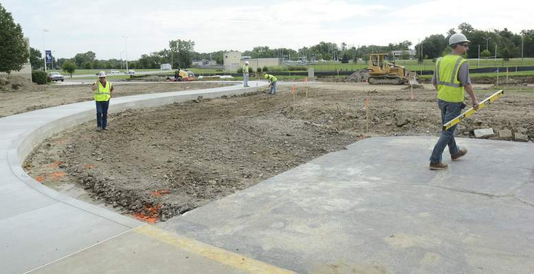 Photos by Cathie Rowand | The Journal Gazette Crosby Excavating and Wayne Asphalt & Construction Co. Inc. prepares for Bishop Dwenger's new chapel. The school will also renovate 36 classrooms as part of the $7.25 million capital campaign project.