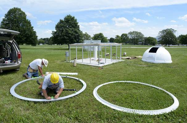 Photos by Samuel Hoffman | The Journal Gazette Dwight Lauinger, left, and Dick Pinckney add rollers to the base ring during construction of IPFW's mini-observatory on the north campus Monday.