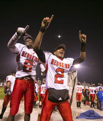 Chad Ryan   The Journal Gazette North Side's Earreis Lewis, left, and Mike Lovett celebrate in the closing seconds of the SAC championship-clinching 42-16 win over Northrop in 2013.