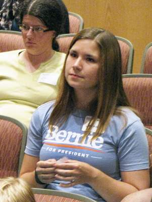 Brian Francisco | The Journal Gazette Jeana Eviston listens to a speaker Wednesday during a campaign organizing event at IPFW's Rhinehart Music Center for Democratic presidential candidate Bernie Sanders.