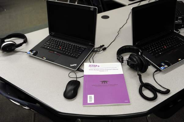 A teacher's manual for the test sits on a computer table where students take the ISTEP test at Emmons Elementary School in Mishawaka, Ind. Wednesday May 1, 2013. Issues with the computer based testing program have caused some problems with the ISTEP test.  The Indiana Department of Education said in a statement that administration of the ISTEP+ exams' online portion resumed Wednesday morning, but that schools are being asked to decrease their daily test load to 50 percent of normal levels until further notice. (AP Photo/Joe Raymond)