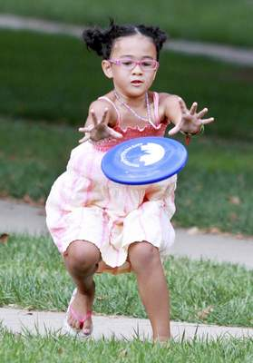 Rachel Von | The Journal Gazette Gianna Hodges, 5, leans in to catch the frisbee during a game with her dad at the Allen County Right to Life Uniting Our City for Life picnic at Headwaters Park on Sunday. The picnic included games, a petting zoo, music, and helped to strengthen awareness about the abortion issue within Fort Wayne and surrounding areas. WITH VIDEO