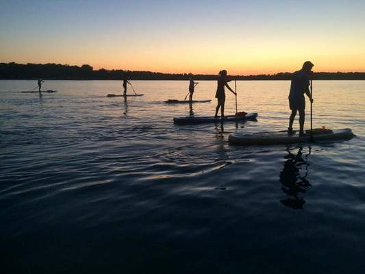 Courtesy Try stand-up paddleboarding at an area lake.