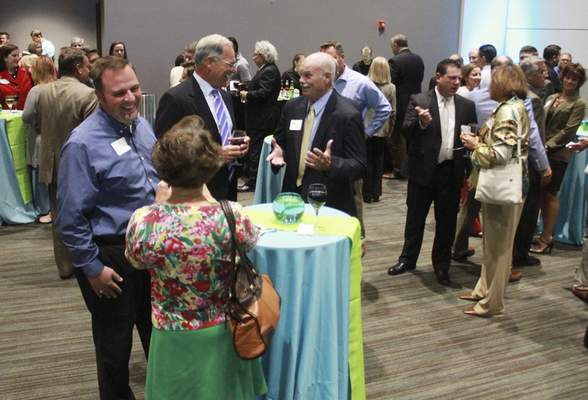 Rachel Von | The Journal Gazette People mingle during a presentation and celebration for the Regional Cities Initiative at the Mirro Center for Research and Innovation, 10622 Parkview Plaza Dr, Fort Wayne, IN on Tuesday. GALLERY