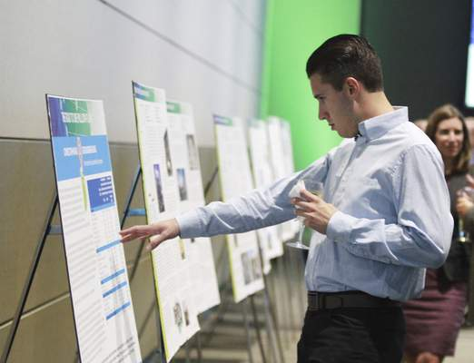 Rachel Von | The Journal Gazette Brett Gauger checks out the projects that are included in the proposal during a presentation and celebration for the Regional Cities Initiative at the Mirro Center for Research and Innovation, 10622 Parkview Plaza Dr, Fort Wayne, IN on Tuesday. GALLERY