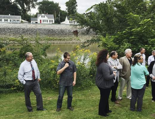 Jamie Duffy   The Journal Gazette Residents gather Tuesday on the banks of the St. Joseph River to celebrate $12 million in improvements that have reduced the number of combined sewer overflows.