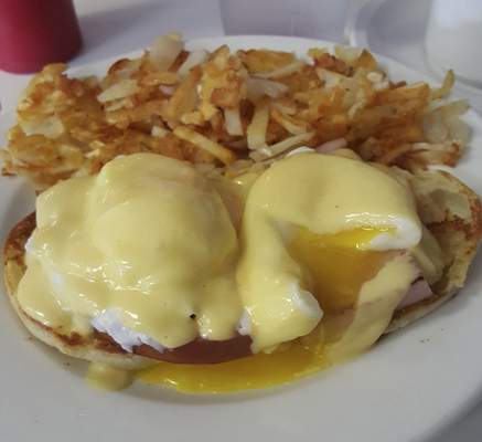 An eggs Benedtict with extra crispy hash browns at Chrome Plated Diner on Anthony Boulevard.