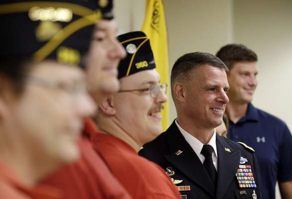 Associated Press Brig. Gen. Malcolm Frost poses with a group of student veterans at IUPUI. As Indiana's veterans return home, attention shifts to making sure they have the services they need.