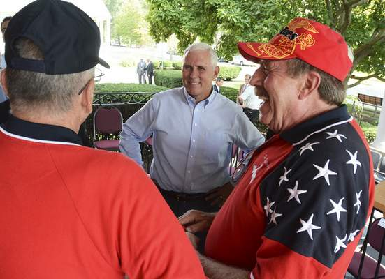 Cathie Rowand | The Journal Gazette Gov. Mike Pence meets with Shepherd's House co-founder Lonnie Cox, right, and executive director Jim Zuber during the open house Tuesday.