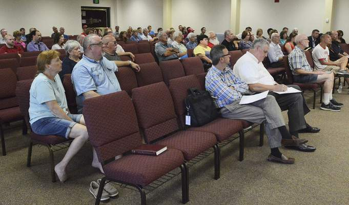 Cathie Rowand | The Journal Gazette Neighbors of a proposed truck hub adjacent to the Allen County GM plant listen to some of the project's particulars Thursday.