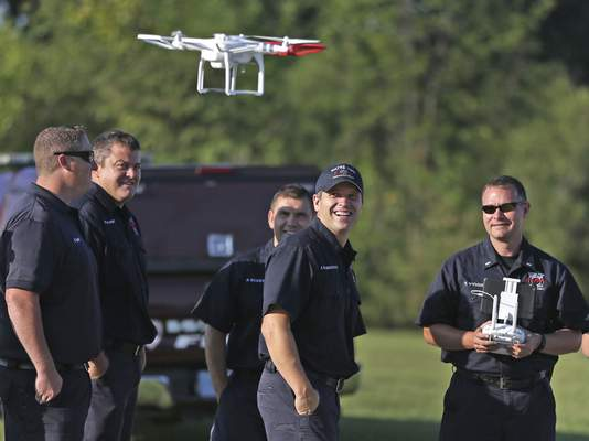 Wayne Township Fire Department firefighters train on drones at the Wayne Township Fire Department Educational Complex, Thursday, Sept.10, 2015. Lt. Troy Wymer, right, gets his turn flying the drone. The departmeny is hoping to use the unmanned aircraft in less picturesque settings, supporting Wayne Township firefighters in all kinds of situations, from hazardous material spills to search-and-rescue operations. (Kelly Wilkinson/The Indianapolis Star via AP) NO SALES; MANDATORY CREDIT