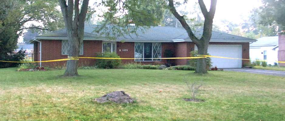 Samuel Hoffman | The Journal Gazette: Police tape blocks the home at 1414 Ludwig Park Drive where a small plane crashed in the back yard early Saturday. Two people were on board but one fled the scene; one person was reportedly in good condition. No one on the ground was injured. The plane clipped trees on Ludwig Park Drive and landed upside down.