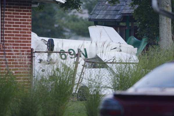 Samuel Hoffman | The Journal Gazette: A small plane crashed in the back yard at 1414 Ludwig Park Drive, early Saturday. Two people were on board but one fled the scene; one person was reportedly in good condition. No one on the ground was injured. The plane clipped trees on Ludwig Park Drive and landed upside down.