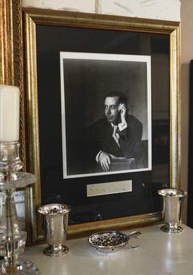 Michelle Davies | The Journal Gazette A signed portrait of songwriter Cole Porter sits on the mantle in the home of Ann Tippmann, the oldest living relative of Porter. Tippmann will be donating some of her memorbilia of Porter for IPFW's upcoming performance of