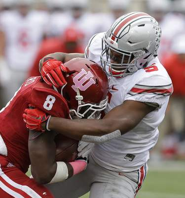Associated Press Ohio State's Raekwon McMillan brings down Indiana running back Jordan Howard during the first half Saturday. Howard injured an ankle in the game and finished with 34 yards.