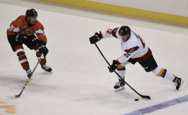 Justin A. Cohn | The Journal Gazette Komets forward Alex Grieve, left, defends Ben Marshall of the Indy Fuel in a preseason game Wednesday.