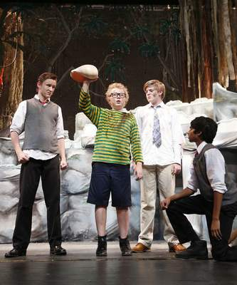 Playing Piggy, Herley Babbitt, 12, holds a conch shell surrounded by, from left, Ben Westropp, 14, Miles Warshauer, 13, and Nithin Krishman, 12.