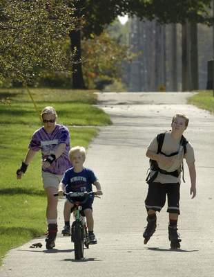 Samuel Hoffman | The Journal Gazette Miriam Kroeker and sons Elias, 6, and Aidan, 11, use the Aboite Trail on Scott Road. The trails system adds to the health score in the index.
