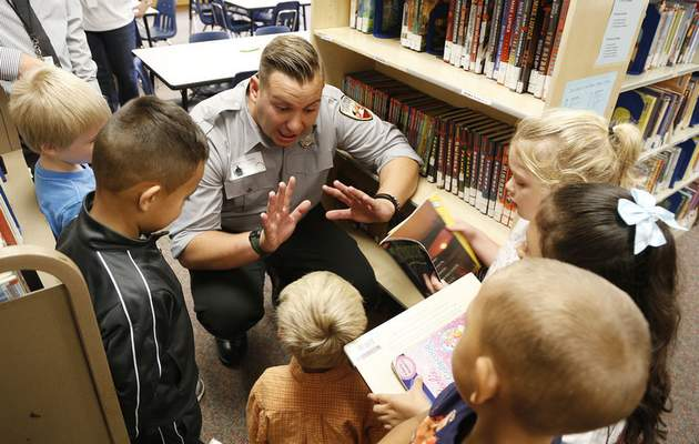 Chad Ryan | The Journal Gazette Fort Wayne firefighter Patrick Shown talks to kindergarten students Thursday at Franke Park Elementary School, where the alum was Principal for the Day. Listening to Shown talk about what to do during a fire drill are, from left, Miles Simon, 6, Jonathan Diaz, 5, Nick Ard, 5, Jamere Brown, 6, Stacy Ausupina, 5, and Caiomhe Rogers, 5.