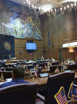 Photo by Cathy Fuentes-Rohwer Michelle Smith, a Bloomington teacher, testifies before a nearly empty House Chamber on Monday. A legislative study committee examining the teacher shortage issue dragged on for hours before members of the general public were allowed to speak.