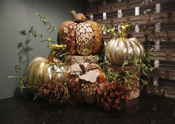 Rachel Von | The Journal Gazette A new trend in Halloween decor expands the color palette, including a harvest theme display of gold and metallic- colored pumpkins at Choice Designs in Fort Wayne.