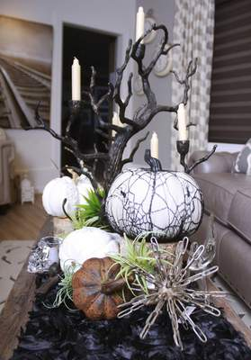Rachel Von | The Journal Gazette The chic steam punk Halloween display includes a lace pumpkin and sculptural metal orbs at Choice Designs, 3223 Carroll Rd. Fort Wayne, IN on Monday.