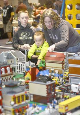Photos by Samuel Hoffman   The Journal Gazette Louise Crawford and her sons Mason, 10, and Zach, 7, check out the tiny town made entirely of Lego bricks Sunday at the Grand Wayne Center.