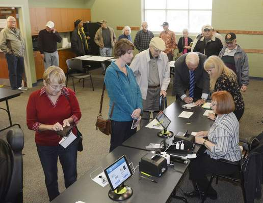 Samuel Hoffman | The Journal Gazette Voters line up to cast early ballots Wednesday at the Georgetown ACPL branch.