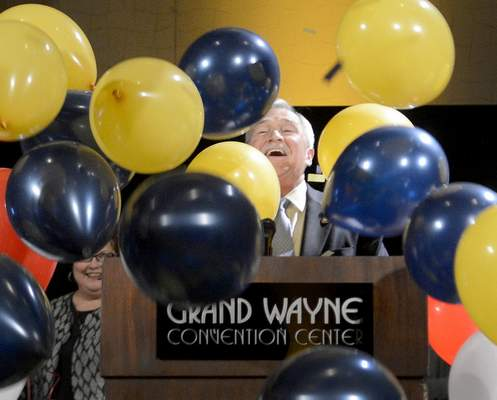 Samuel Hoffman | The Journal Gazette Balloons and confetti await Democrat Tom Henry and wife Cindy, left, at an election night victory party at Grand Wayne Center after Henry won a third consecutive term as Fort Wayne's mayor.
