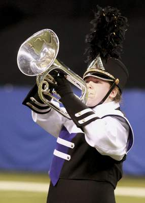 """Angola's Jenna Grant plays the mellophone during the marching band's performance of """"A Torch to Light the Way."""""""