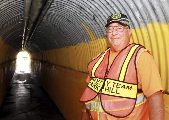 Rachel Von | The Journal Gazette  Portrait of Robert Barwiler the tunnel guy in the underground tunnel that leads from New Haven Middle School to New Haven High School on Friday. Robert Barwiler not only monitors the tunnel but keeps kids behaving.