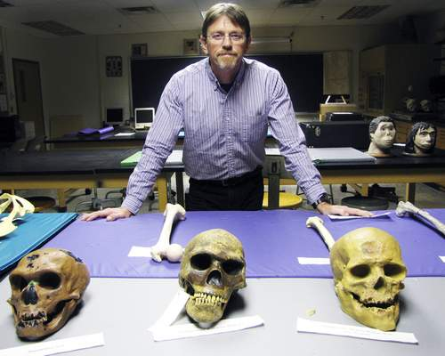 Brian Francisco | The Journal Gazette IPFW anthropology professor Lawrence Kuznar, shown in the anthropology lab at Kettler Hall, has been analyzing Islamic State messaging and speech patterns for the Department of Defense.