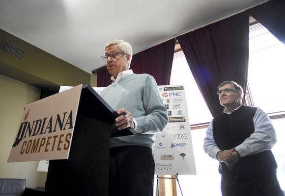 Rachel Von | The Journal Gazette Tony Henry, right, looks on as Asher CEO Tim Borne speaks during a press conference for Indiana Competes at 816 Pint & Slice in downtown Fort Wayne, IN on Tuesday. Indiana Competes is a statewide business coalition supporting civil rights protections for lesbian, gay, bisexual and transgender Hoosiers.