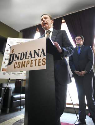 Rachel Von | The Journal Gazette Peter Hanscom, right, looks on as John Crawford speaks during a press conference for Indiana Competes at 816 Pint & Slice in downtown Fort Wayne, IN on Tuesday. Indiana Competes is a statewide business coalition supporting civil rights protections for lesbian, gay, bisexual and transgender Hoosiers.