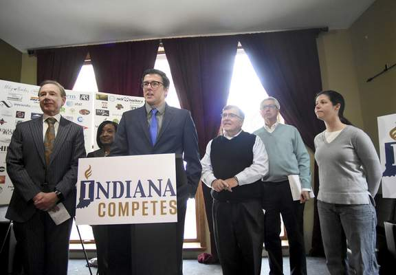Rachel Von | The Journal Gazette Peter Hanscom, center, backed by local leaders and business owners speaks during a press conference for Indiana Competes at 816 Pint & Slice in downtown Fort Wayne, IN on Tuesday. Indiana Competes is a statewide business coalition supporting civil rights protections for lesbian, gay, bisexual and transgender Hoosiers.
