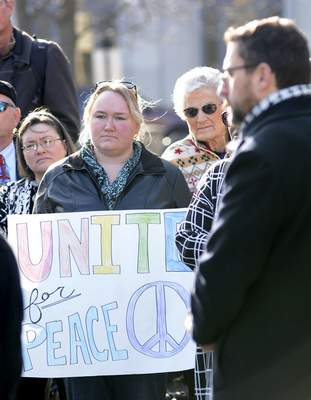 Samuel Hoffman | The Journal Gazette: Karri Pulley was one of more than 100 people who attended the rally Friday on the Courthouse Green.