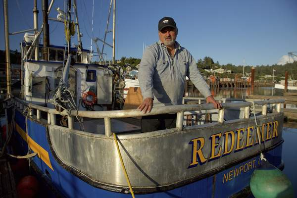 """Discovery Channel This photo provided by courtesy of Discovery shows Captain Gary Ripka standing on his boat, the FV Redeemer, at the dock in Newport, Ore., the setting of """"Deadliest Catch: Dungeon Cove,"""" airing in the fall of 2016 on Discovery. (Discovery via AP)"""