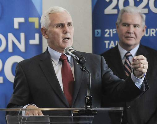 Michelle Davies | The Journal Gazette Gov. Mike Pence discusses Fort Wayne's Regional Cities Initiative funding and the Road to One Million plan Tuesday afternoon during his visit to the city.