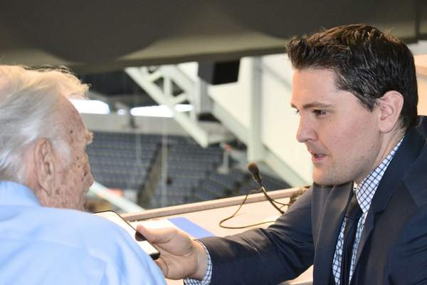 Justin A. Cohn | The Journal Gazette Chris Treft, right, interviews longtime Komets broadcaster Bob Chase before Monday's game between the Komets and Atlanta Gladiators. Treft, who grew up a fan of the Komets in Roanoke, is in his first season as the voice of the Gladiators.