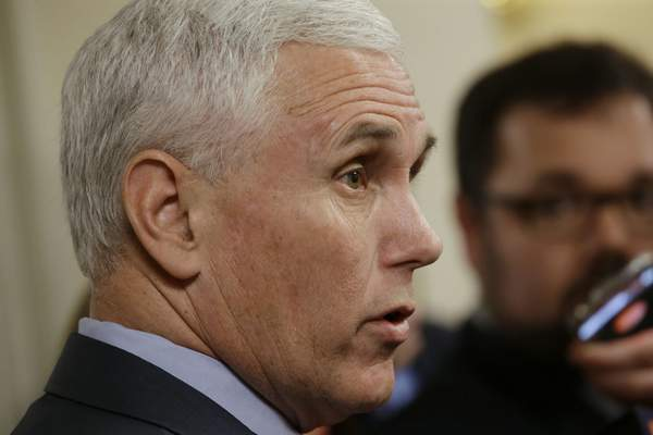 FILE - In this file photo taken on Wednesday, April 29, 2015, Indiana Gov. Mike Pence speaks with the media after emerging from Speaker of the House Brian Bosma's, R-Indianapolis, office on the final day of the 2015 legislative session at the Statehouse in Indianapolis. (AP Photo/AJ Mast, File)