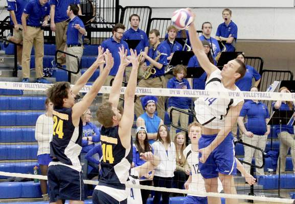 Rachel Von   The Journal Gazette From left: Alderson Broaddus' Tyler Smith, and teammate Eric Bowman try to block a hit from IPFW's David Frazee during the IPFW Mastodons vs. Alderson Broaddus Battlers men's volleyball game at the Gates Center at IPFW in Fort Wayne, IN on Friday. GALLERY