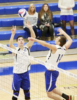 Rachel Von   The Journal Gazette IPFW's Michael Keegan, left, sets up teammate David Frazee so he can hit the ball during the IPFW Mastodons vs. Alderson Broaddus Battlers men's volleyball game at the Gates Center at IPFW in Fort Wayne, IN on Friday. GALLERY