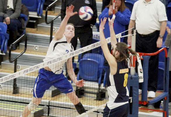 Rachel Von   The Journal Gazette Alderson Broaddus' Justin Glader, right, tries to block a hit from IPFW's Michael Keegan during the IPFW Mastodons vs. Alderson Broaddus Battlers men's volleyball game at the Gates Center at IPFW in Fort Wayne, IN on Friday. GALLERY
