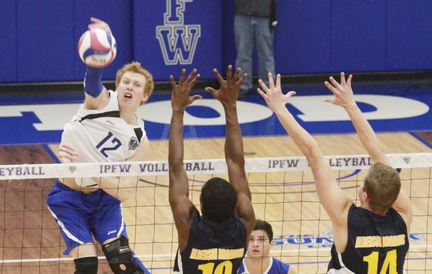 Rachel Von   The Journal Gazette From left: IPFW's Andrew Sellan blasts the ball over Alderson Broaddus' Obenda Besongngem and Eric Bowman during the IPFW Mastodons vs. Alderson Broaddus Battlers men's volleyball game at the Gates Center at IPFW in Fort Wayne, IN on Friday. GALLERY
