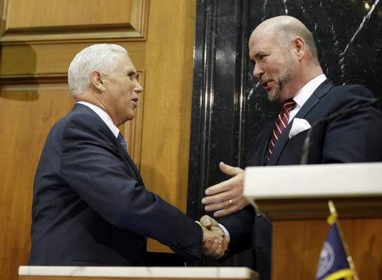 Indiana Gov. Mike Pence talks with House Speaker Brian Bosma, R-Indianapolis, before he delivers his State of the State address to a joint session of the legislature at the Statehouse, Tuesday, Jan. 12, 2016, in Indianapolis. (AP Photo/Darron Cummings)