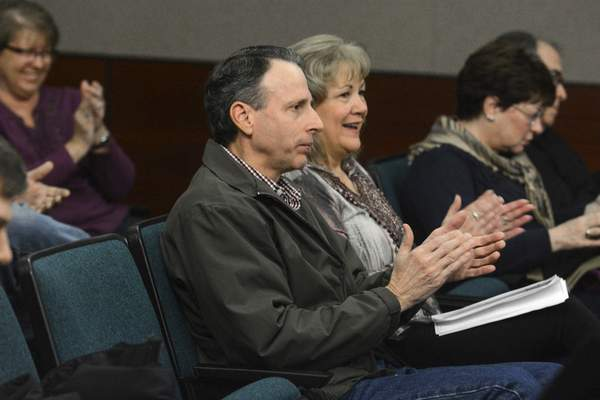 Michelle Davies   The Journal Gazette Don Bracht and Shari Bracht, residents of Azbury Woods, applaud as Allen County commissioners voted to reject rezoning the 13200 block of Winters Road in Lafayette Township.