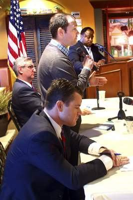 GOP candidates for US Senate, from left, Todd Young, Marlin Stutzman and Eric Holcomb debated on Saturday, January 16, 2016, in Kokomo, Indiana. Stutzman talks about being a farmer along with his pro-life, pro-gun beliefs. (AP Photo/Kokomo Tribune, Tim Bath)