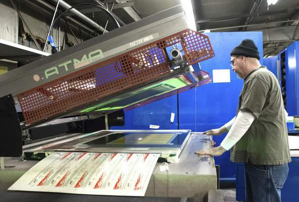Michelle Davies   The Journal Gazette Bob Geerken, Print Supervisor at Prentice Products, lines up metal sheets for printing. Prentice Products, a full-service screen printing, digital printing and metal etching company, the latest investment of the Regional Angel Investment Network.