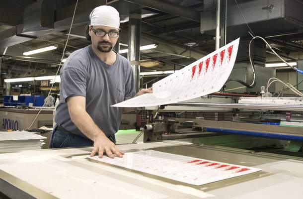 Michelle Davies   The Journal Gazette Chris Martin, a screen printer at Prentice Products, removes a finished sheet and places another one on the bed of the printer. Prentice Products, a full-service screen printing, digital printing and metal etching company, the latest investment of the Regional Angel Investment Network.