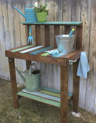 Filling pots with soil this spring will be easier with a potting bench built from pallet wood.